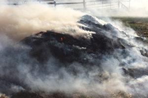 Burning Hay Piles